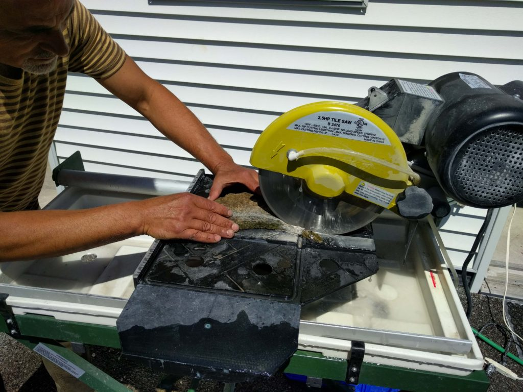 We used a tile saw to reduce the thickness of the new piece of limestone.