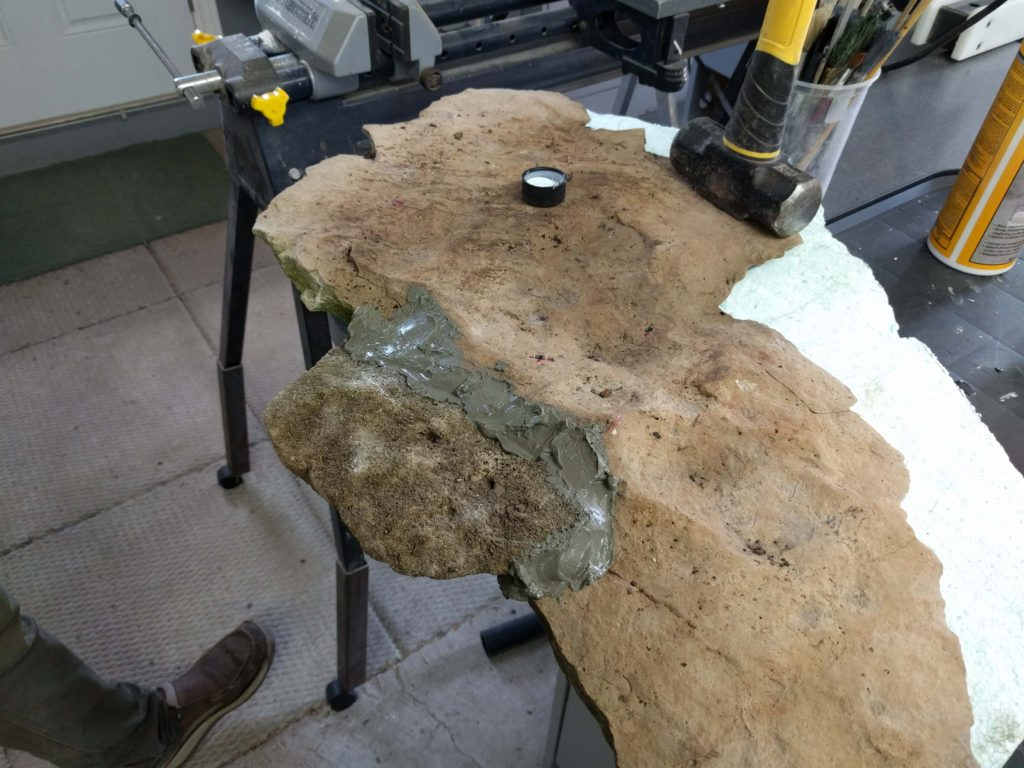 Concrete adhesive was used to permanently affix the two pieces together.